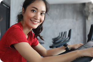 Woman smiling while exercising